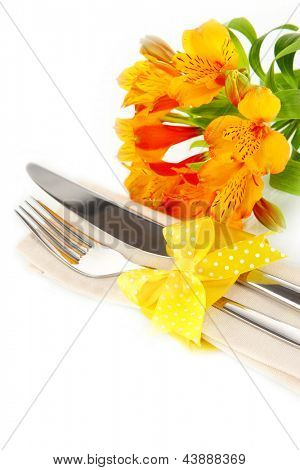 Festive dining table setting with flowers isolated on white