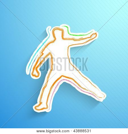 Cricket bowler in playing action on blue background.