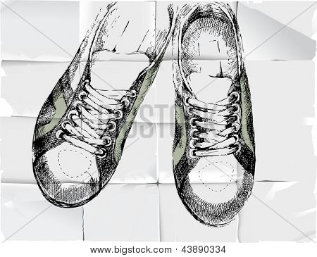 Hand drawn sneakers over crumpled paper background