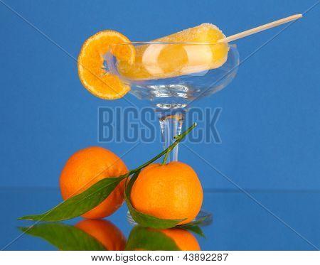 Yellow fruit juice ice in vase on blue background