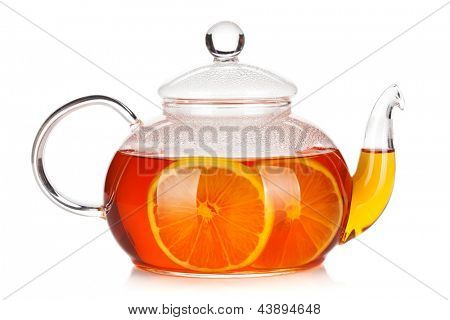 Glass teapot of black tea with lemon. Isolated on white background