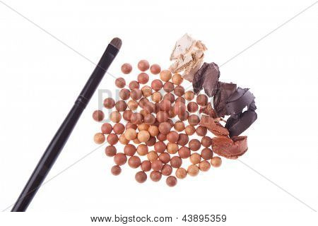 bronzing pearls and cream eyeshadows with brush isolated on white background