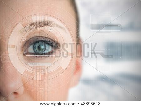 Close up of woman blue eye analyzing chart interfaces on blur background