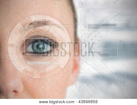 Close up of woman eye analyzing charts with circuit board background