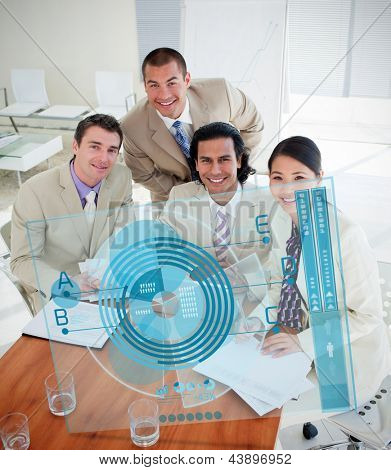 Overview of happy colleagues using blue chart interface in a meeting