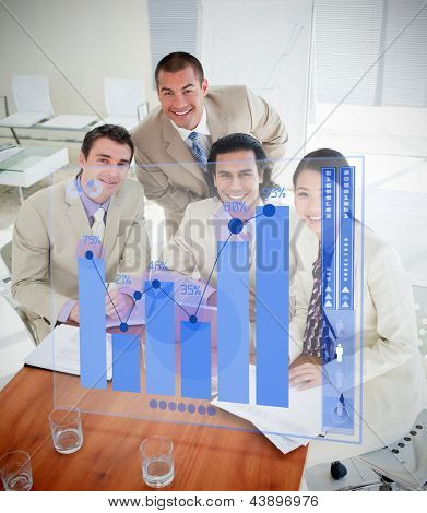 Overview of cheerful colleagues using blue chart interface in a meeting