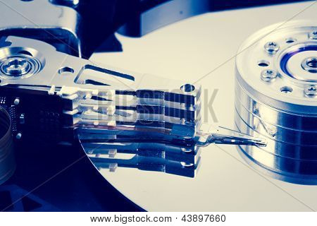 Close up of hard disk drive in blue tint of computer