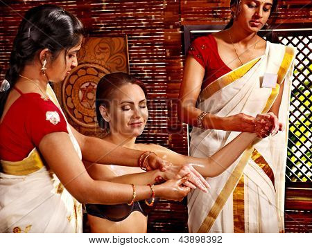 Young woman having ayurveda spa treatment.