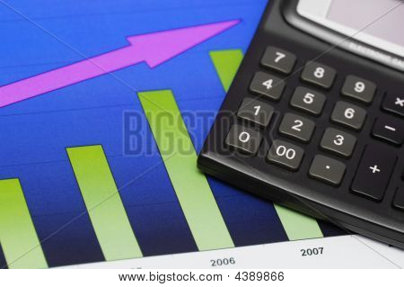 Close Up Of Chart Showing Growth And Calculator