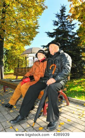 Two Old Peple Sit On Bench