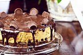 stock photo of cheesecake  - Home made chocolate peanut butter cheesecake on the table - JPG
