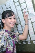 Female Worker At Absent Punch Card Smiling poster