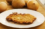 stock photo of collate  - potato pancake on a plate and ingredients - JPG