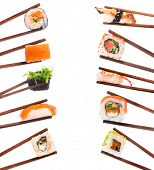 stock photo of soy sauce  - Set of sushi with chopsticks shot on white - JPG