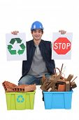 Construction worker encouraging people to recycle waste
