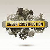 stock photo of reconstruction  - Under construction sign with gears - JPG