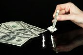 picture of methadone  - Cocaine drugs lines and female hand holding rolled dollar banknote - JPG