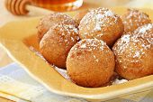 Homemade pancake balls (cinnamon recipe) deep fried - by dropping spoonfuls of batter into fryer - a