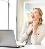 bright picture of happy woman with laptop computer