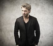 stock photo of beard  - handsome man dressed in black jacket - JPG