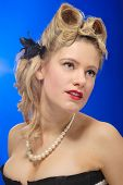 Cute Fifties Girl With Victory Roll Hairstyle poster