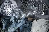 pic of centrifuge  - Internal view of washing machine drum filled with clothes - JPG