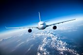 stock photo of aeroplane  - Passenger Airliner flying in the clouds - JPG