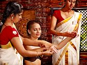 pic of panchakarma  - Young woman having ayurveda spa treatment - JPG