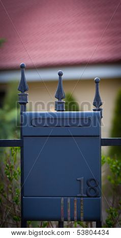 Cloes up of a mailbox on the street with fence