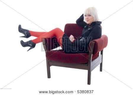 Blonde Girl In A Soft Chair