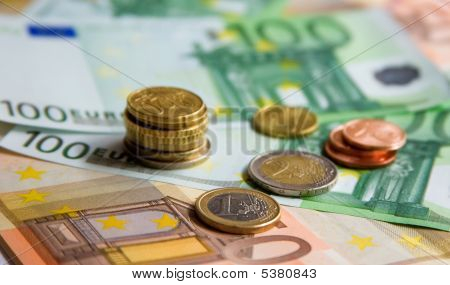 Financial Background. Different Euro Banknotes And Coins
