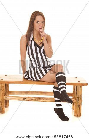 Woman Referee Sitting and blowing whistle