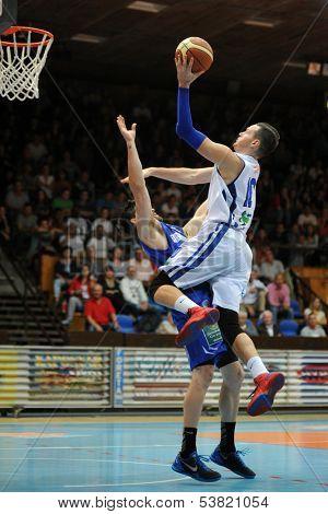 KAPOSVAR, HUNGARY �¢�?�? OCTOBER 26: Jancsikin Branislav (in white) in action at a Hungarian Championship basketball game with Kaposvar (white) vs. Fehervar (blue) on October 26, 2013 in Kaposvar, Hungary.