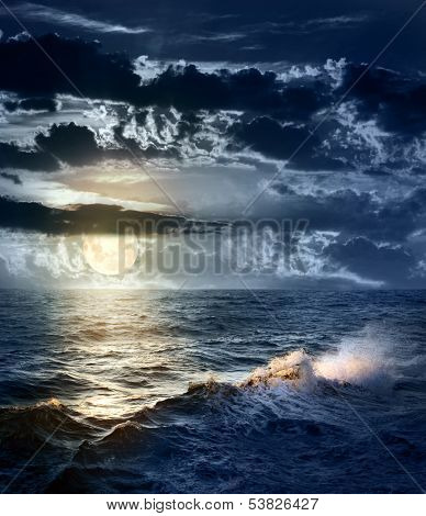 Stormy Sea at Night with dramatic sky and the big Moon -  beautiful and dangerous weather