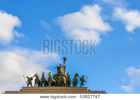 Triumphant statue against the blue cloudy sky