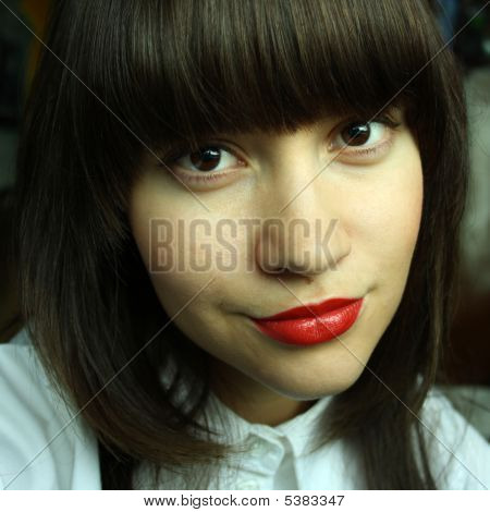Young Seductive Woman With Red Lipstick