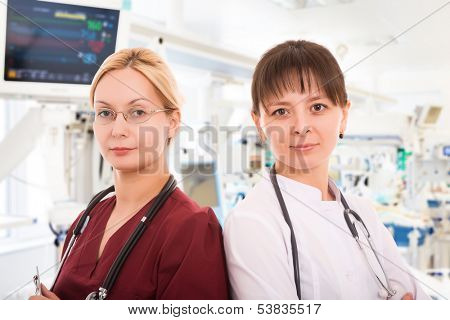 Two young female doctors in intensive care unit