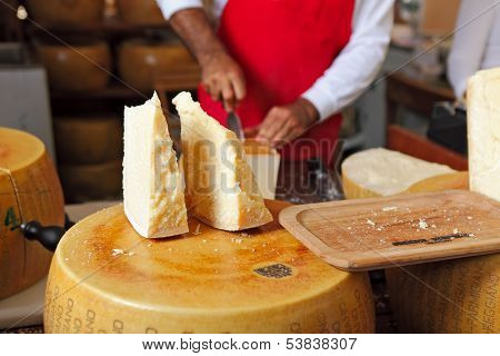 BRA - SEPTEMBER 22: Cut pieces of Parmesan - famous italian hard cheese made from raw cow's milk, often grated over dishes and named after producing areas near Parma, Italy on September 22, 2013.