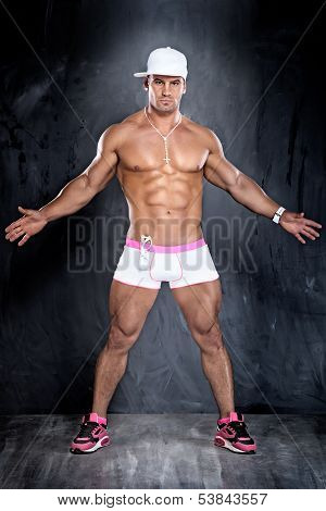 Muscular Young Handsome Man Posing.