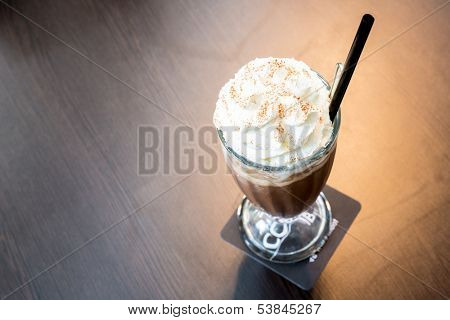 Cup of iced mocha coffee with whipping cream