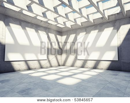 Large concrete hall with empty billboards