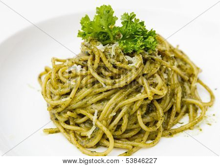 Italian pasta spaghetti with pesto sauce and basil leaf