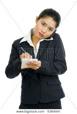 Business Woman On The Phone Taking Notes