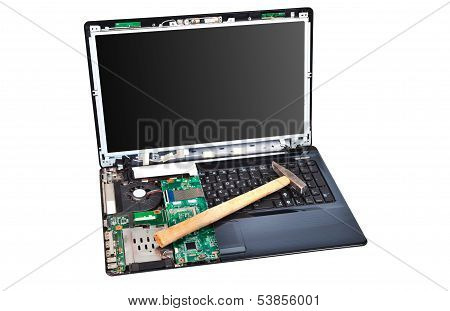 Laptop Half Disassembled With Hummer On It