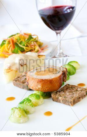 Suckling Pig Steak Served With Wine