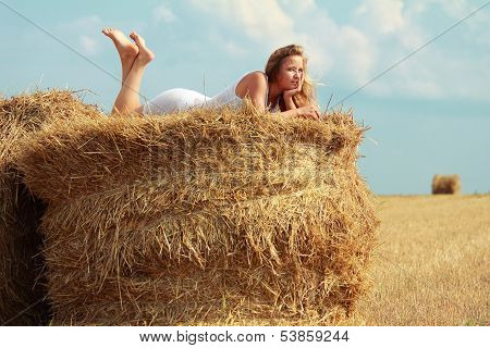 Girl On Straw Roll