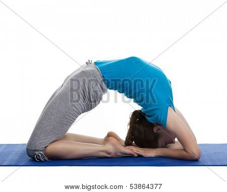Yoga - young beautiful woman yoga instructor doing Pigeon pose asana(kapotasana) exercise isolated on white background