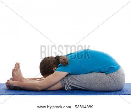 Yoga - young beautiful woman yoga instructor doing Seated Forward Bend or Intense Dorsal Stretch pose asana (Paschimottanasana) exercise isolated on white background
