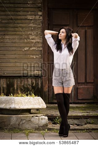 Fashion Pretty Young Woman Posing Outdoor