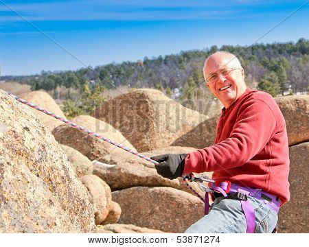 Rock climbing senior male